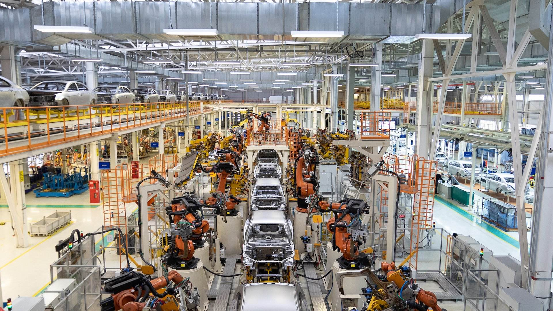 Car manufacturing plant with robots